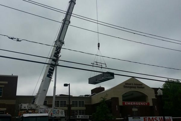 Setting an 8, 000 lbs. air conditioning unit today at a local hospital.