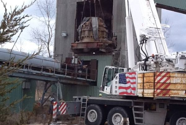 The crusher weighed 66 ton and was taken out of the building and set on the ground. It was then brought to another location to be used elsewhere.