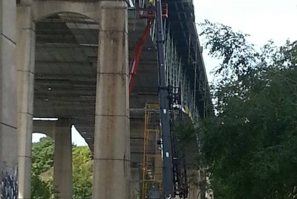 Picture of crane working under bridge on Interstate 90.