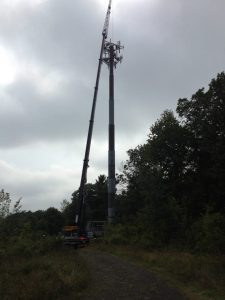 Working on a cell tower with our 90 ton Link-Belt. The customer used a man basket to replace 3 antennas on the tower.