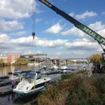 Taking boats out of the river for the winter.
