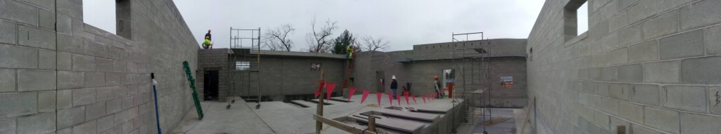 Panorama of job site before the first piece of concrete plank roof is set.