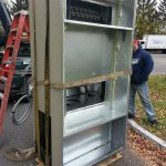 Rigging the new A/C unit. (Back)