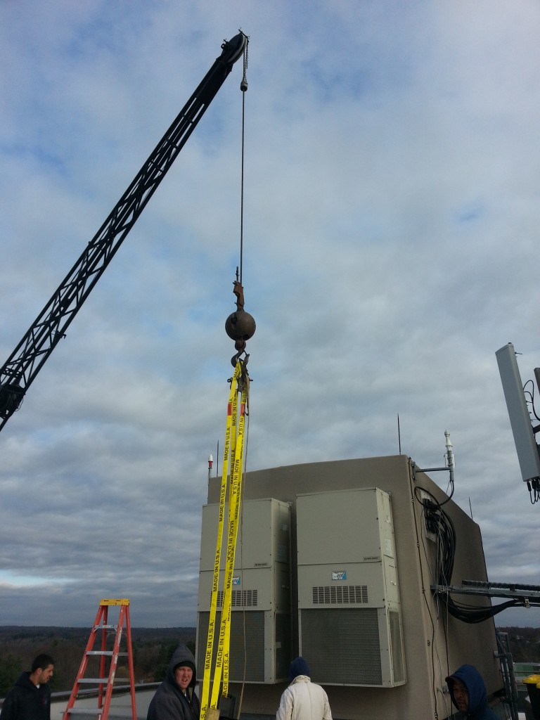 Shot from the roof. Getting ready to hook one of the small A/C units on the side of this cell building.