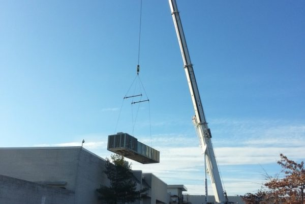 Setting large A/C units at Crossgates Mall in Guilderland, NY with our 220 ton crane.