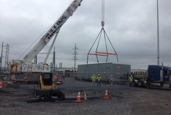 Setting 70,000 lb. building with our 2-18 ft. spreader bars good for 40 ton each.
