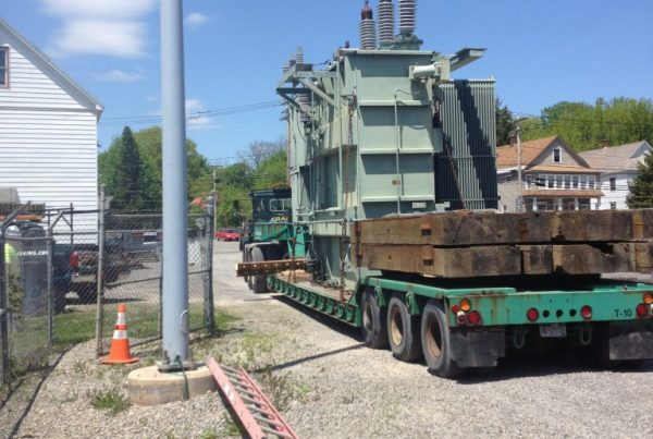 Old generator that we lifted onto one of our trailers to be moved out of the way and unloaded to make room for the new transformer.