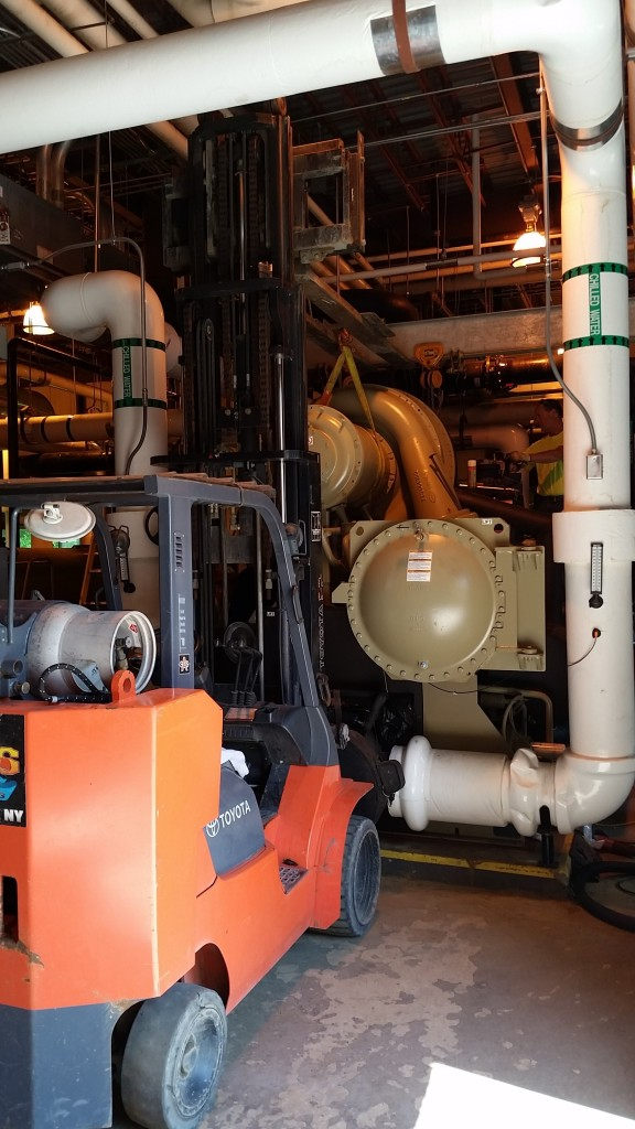 Taking a compressor off a chiller to replace an O-ring. One side is supported by our 10,000 lb. forklift.