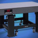 An optical table is a platform that is used to support systems used for optics experiments and engineering.