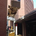 Hoisting one of four generators out of alley way with kevlar straps and chainfalls.