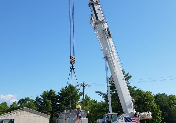 Loading a transformer that weighs 93,000 lbs. onto our trailer.