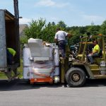 Using our fork truck to unload MRI out of box trailer.