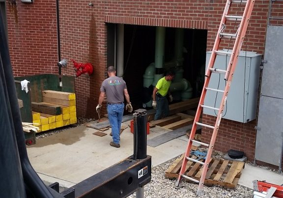 Setting a wood crib up to install chiller into basement floor
