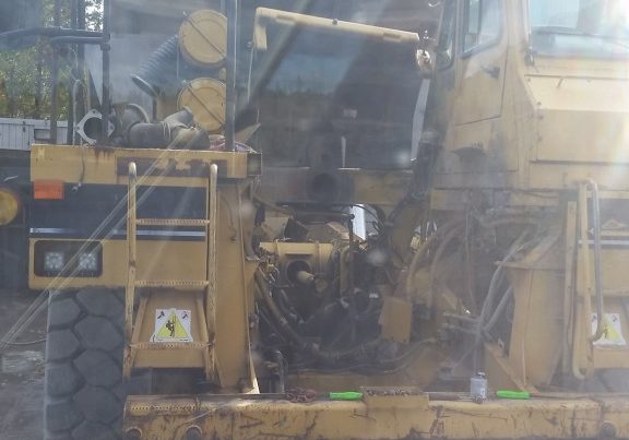 Lifting a 6,000 lb. engine into a 988 loader.