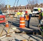Setting in the middle of a busy street in Schenectady, NY setting a concrete vault.
