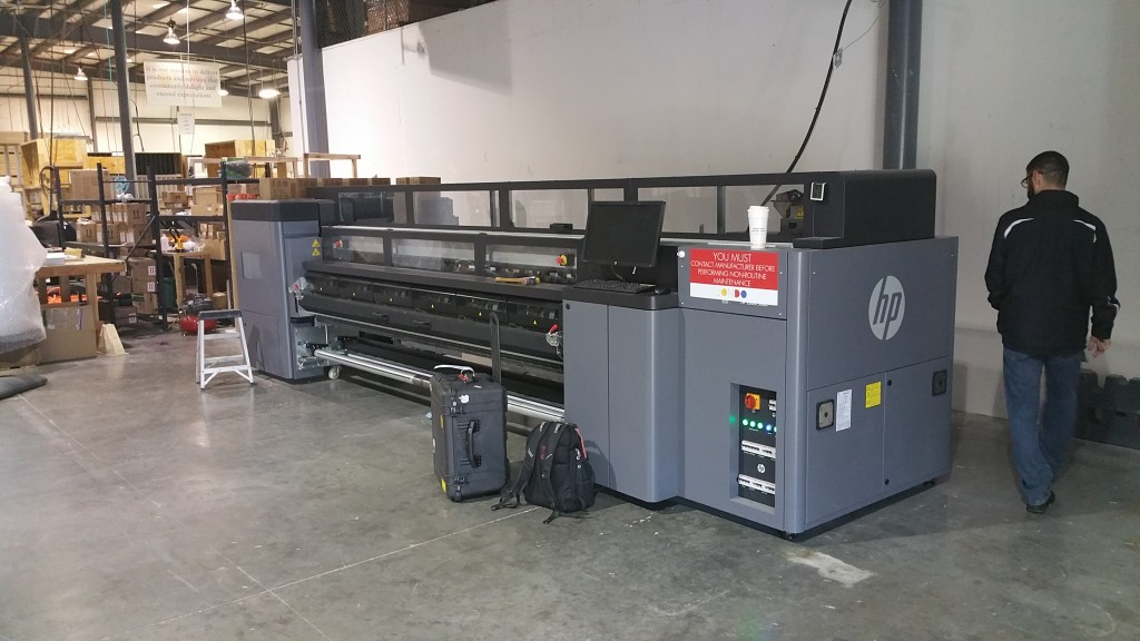 We really enjoyed working on this job as we helped move a photo printing company's factory from one location to another. JONDO is a worldwide company. Their products are amazing and can be found in national chains such as Costco. Pictured here is one of their large printers.