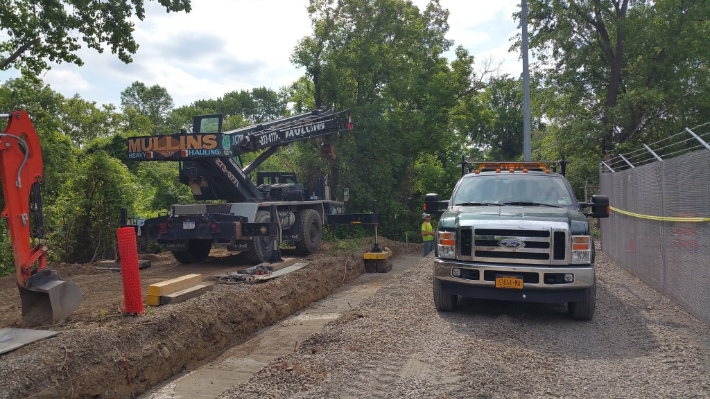 Our 22 ton crane setting precast footings for a flood wall near the Mohawk River.