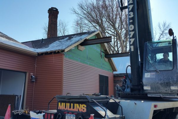 Another unique job done by Mullins Rigging. The home owner wanted a second story to their home. The builder wanted to keep the roof intact. So what do you do. Call us up and have us pick the roof off of the building. We lift the roof off by sliding two large beams through the builiding and picking from these points. Once the roof was off the builder builds the second floor and then we return to set the roof back on top. We make the impossible possible at Mullins Rigging.