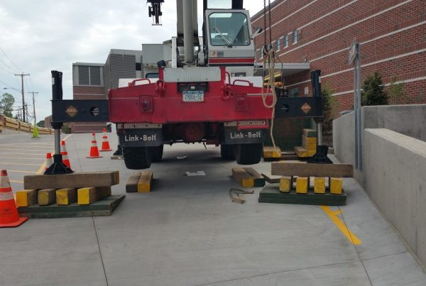 Extra blocking required to level the crane because of the steep ramp of the Emergency Room entrance.