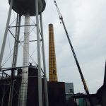 Lifting men in a man basket in Green Island, NY to inspect a smoke stack.