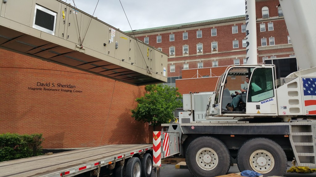 Lifting new A/C unit for Albany Medical Center