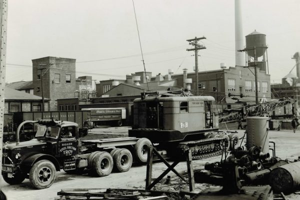Mullins Rigging transport of crane. Note position of truck exhaust and crank out windows on tractor