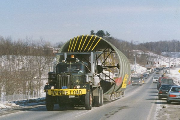 Mullins Rigging loaded transport smoke sections from Troy Boiler Works to general electric plant- Selkirk N.Y.- Special trailer deck designed and fabricated by Mullins to accommodate large diameter stacks (17 foot diameter) for road movement.