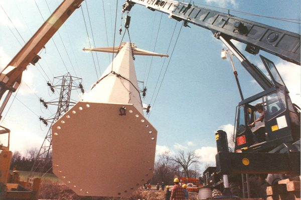 Mullins Rigging raising of power pole between energized electrical lines