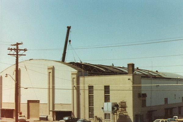 Mullins Rigging removal of roof trusses at R.P.I. (Houston Field house)