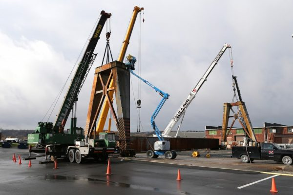 Mullins Rigging disassembly of overhead crane from the Watervliet Arsenal using four cranes.