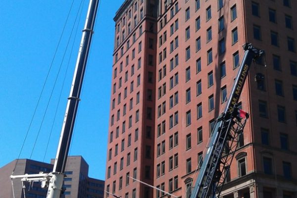 Mullins Rigging cooling tower coil replacement on 24 story Bldg. – Albany, N.Y.
